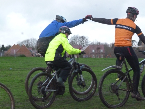 Riding in close proximity in preparation for cyclo-cross racing.